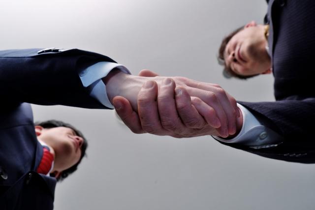 事業承継の握手